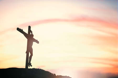 christmas prayer: Silhouette of Jesus with Cross over sunset concept for religion, worship, Christmas, Easter, Redeemer Thanksgiving prayer and praise