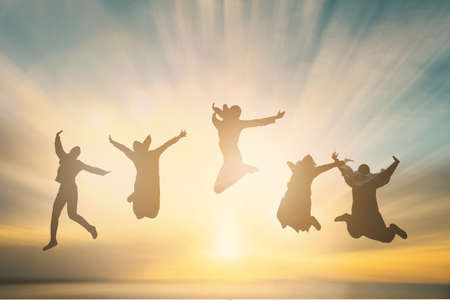 Silhouette of cheering young muslim generation jumping on outdoor beautiful Rear view background. concept relax lifestyle hope faith love grow kid hands Happiness fitness exercising volleyball future party relation