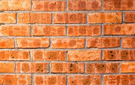 Close-up bright vintage bricks wall background. Stock Photo