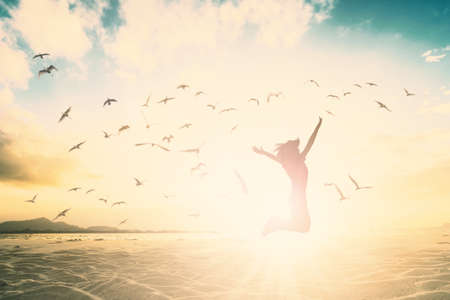Silhouette of woman cheering new generation jump on beautiful background.
