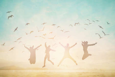 Silhouette man jump and open arms up on beautiful beach concept for Financial freedom, mission complete, travel in summer high season.  Imagens