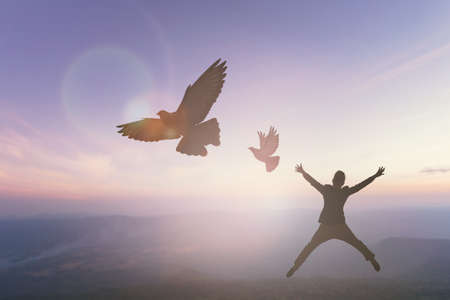 Happy man rise hand on morning view. Christian inspire praise God on good friday background. Now one man self confidence on peak open arms enjoying nature the sun concept world wisdom fun hope Stockfoto