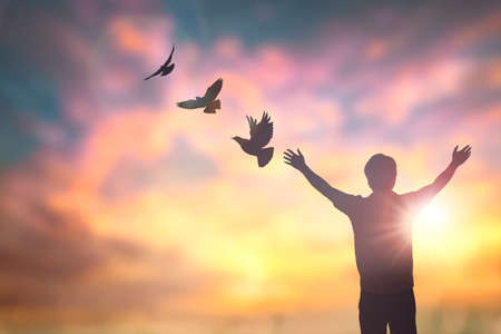 Happy man rise hand on morning view. Christian inspire praise God on good friday background. Now one man self confidence on peak open arms enjoying nature the sun concept world wisdom fun hope Фото со стока