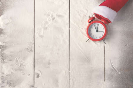 Vintage Bauble Christmas celebration on wood table top view background concept for clock countdown decoration on empty rustic desk with snow, Merry Christmas and Happy new year mockup product card