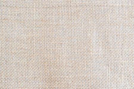 Zurück brauner Stoff Leinwand Textur Hintergrund mit Leerzeichen für Textdesign. Sauberes gelb-beiges hessisches Sackleinen Wollfalte gewebtes Konzept cremefarbene Sackmusterfarbe, Retro-Baumwolltuch.