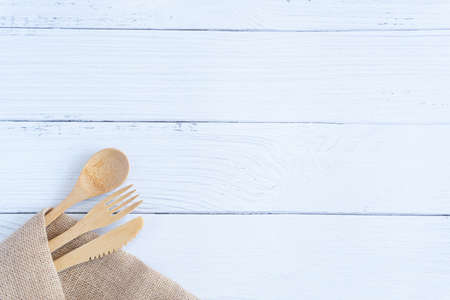 Bamboo wood toothbrush on clean white marble table top view background concept for save the earth day, world environmental, plastic free, kitchen flat lay lifestyle, bathroom reusable wood product.