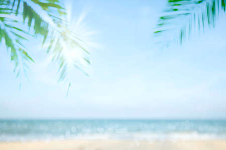 Abstract soft blur nature tropical beach with green coconut palm leaf and light wave bokeh background concept for blurry sky summer landscape water and sand, holiday ocean travel, relax vacation day 写真素材 - 122401057