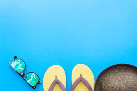 Vibrant Retro youth fashion flat lay on top view blue background texture concept for minimal summer product mock up, uv protect outfit design, turquoise beach set for weekend vacation. Stock Photo