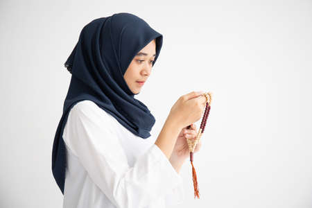 Silhouette young female muslim prayer with hijab praying to God front of landscape view concept for eid mubarak, life and soul fasting of international islamic ramadan, Namaz.