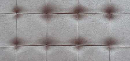 Light black luxury upholstery sofa texture background concept for clean gray vintage leather furniture pattern wallpaper, closeup interior elegant armchair mattress surface detail, real tuft material.