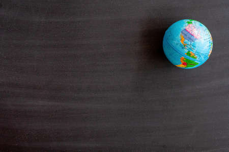 World map on Blank front Real black chalkboard background texture in college concept for back to school kid wallpaper for create white chalk text draw graphic. Empty old back wall education blackboard. Stock fotó