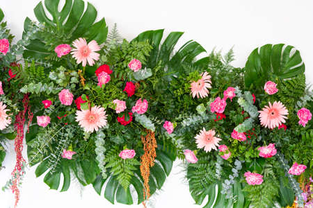 Tropical leaves and flower foliage plant bush floral arrangement nature isolated on white background, clipping path included. Stock fotó
