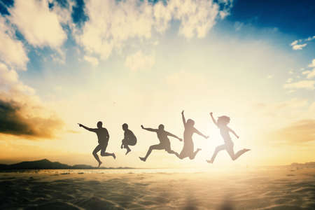 Happy family people group celebrate jump for good life on weekend concept for win victory, person faith in financial freedom healthy wellness, Great insurance team support retreat together in summer. Stock Photo