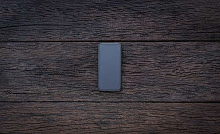 Vintage smartphone mockup flat lay on old wood table top wood background texture space concept workspace office blank empty display view, stay and work business blogger idea at home Stock fotó