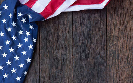 America flag waving pattern on wooden background in table top view, red blue white strip concept for USA 4th july independence day, symbol of patriot freedom and democracy. Glory pride in memorial day of liberty Stock fotó