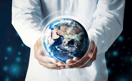 Businessman hand holding multinational hologram globe concept for world map responsibility, cloud internet network connection, international tech information, global education classroom online, CSR earth ecosystem Stock fotó