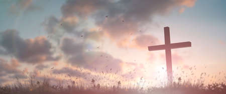 Silhouette jesus christ crucifix on cross on calvary sunset background concept for good friday he is risen in easter day, good friday jesus death on crucifix, world christian and holy spirit religious. 免版税图像
