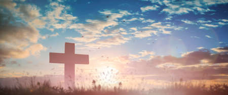 Silhouette jesus christ crucifix on cross on calvary sunset background concept for good friday he is risen in easter day, good friday worship in God, Christian praying in holy spirit religious. Zdjęcie Seryjne