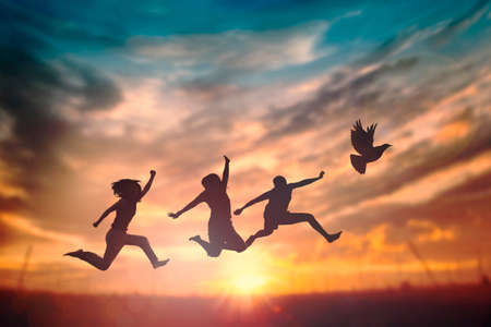 Happy family people group celebrate jump for good life on weekend concept for win victory, person faith in financial freedom healthy wellness, Great insurance team support retreat together in summer. 版權商用圖片