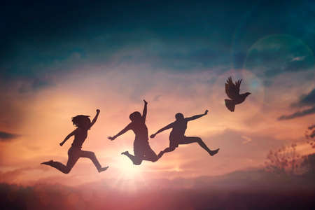 Happy family people group celebrate jump for good life on weekend concept for win victory, person faith in financial freedom healthy wellness, Great insurance team support retreat together in summer. Фото со стока