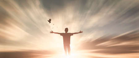 Silhouette woman with hands rise up on beautiful view. Christian praise on hill thanksgiving day background. support nature standing open arms enjoying sun concept jesus fun world wisdom 2021 스톡 콘텐츠