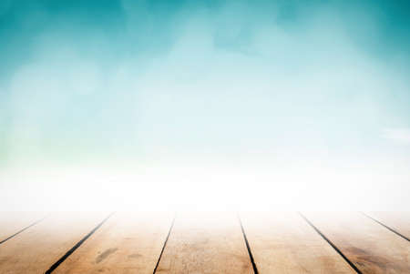 Abstract perspective clean wooden table top on blur grocery background concept for product pub floor on blue nature beach water. Christmas lunch breakfast garden in summer pastel teal bokeh mint green