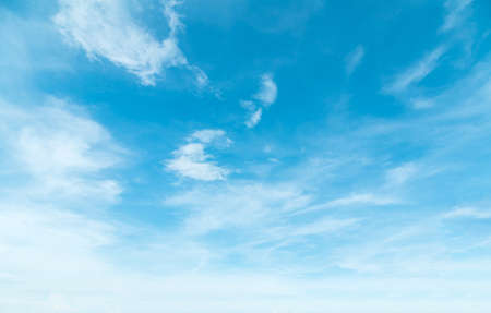 Summer Blue Sky and white clouds background. Beautiful clear cloudy in sunlight spring season. Panorama vivid cyan cloudscape in nature environment. Outdoor horizon skyline with spring sunshine.