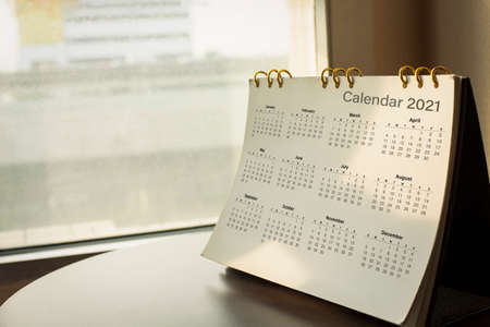 Desk calendar diary on hotel office table with year 2021 work place. Planning scheduling agenda, Event, organizer of plan 2020 to 2022. appointment, organization, management each date, month concept