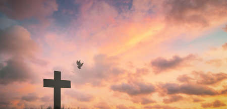 Jesus cross crucifixion on calvary hill in sunrise good Friday risen in easter day morning Sunday concept for Christian praise for holy spirit religious God, Catholic church pray star dawn background.