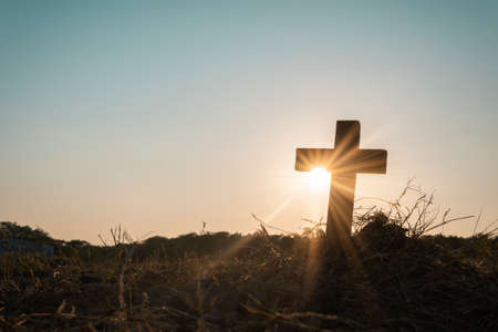 Silhouette jesus christ crucifix on cross on calvary sunset background concept for good friday he is risen in easter day, good friday worship in God, Christian praying in holy spirit religious. Stock fotó