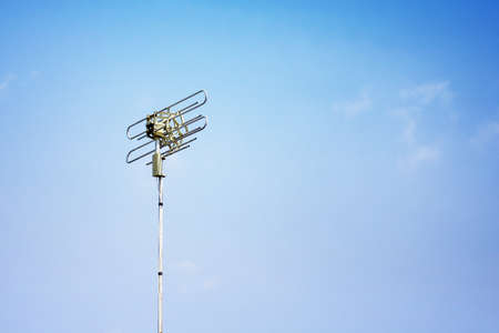 telecoms: single Telecoms mast in a rural blue sky landscape Stock Photo