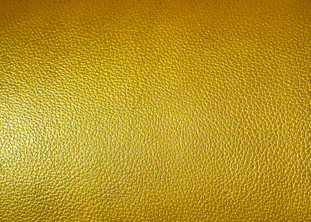 leatherette: Surface of yellow leatherette texture as background