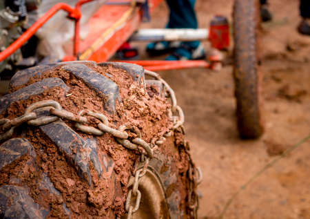 close up heavy muck  truck wheel  off road car tire with chain on it