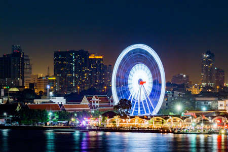 Bangkok, Thailand - Aerial view Bangkok city night view Modern building condominium temple Asiatique Teh Riverfron ,Asiatique ferris Wheel near River in town ,Thailand