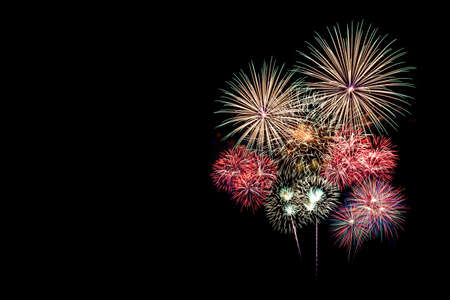 Festive patterned of Colorful assorted firework bursting in various shapes sparkling pictograms set against black background abstract  Stock Photo