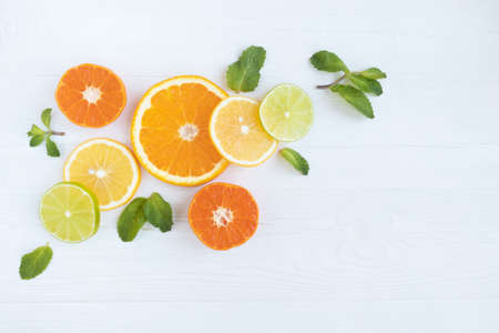 Lemons, lime, orange and grapefruit tangerines and kiwi cut into circles on a white background with space for text. Poster, banner, article.