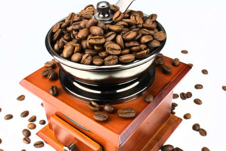 Manual coffee grinder with coffee beans shot over black background photo
