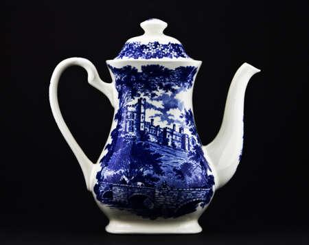 White teapot on the black background. Stock Photo - 12588850