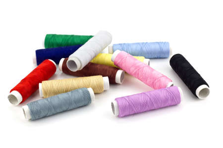 Sewing thread on white background photo