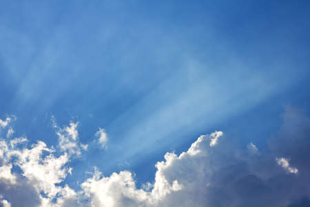 Clouds and a blue sky and sunbeam shining through it  Stock Photo - 15206434