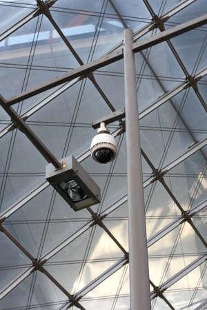 Camera Operating on train station platform photo