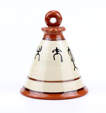 antiquary: ceramic bell. Isolated on a white background. Stock Photo