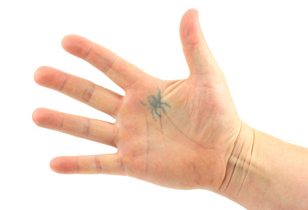 hand with a tattoo on a white background photo