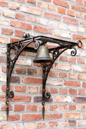 bell bronze bell: beautiful bronze bell on a brick wall
