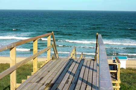 german north sea region: Wooden footpath through dunes at the North sea beach in Germany.