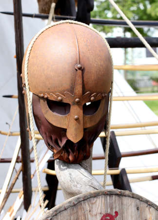 midday: authentic restored viking helmet under the high midday sun