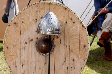 weaponry: Viking weaponry.  shield and helmet at a historical reenactment festival