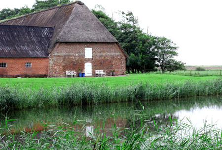 westerhever: an old farmhouse on the lake. Germany