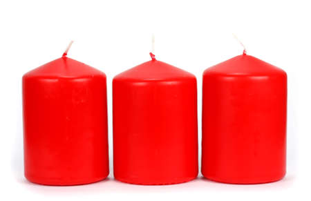 stocky: Three red candle wax on a white background Stock Photo