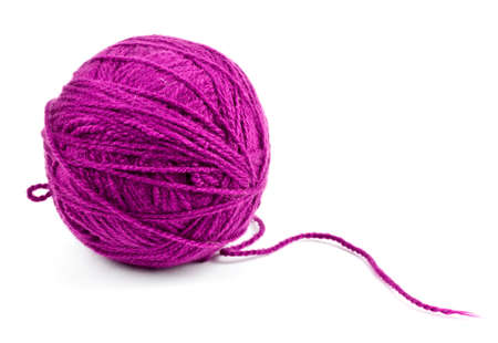 yarn: close up of wool knitting on white background